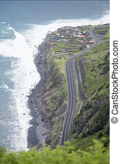 the highway at the village Ribeira da Janela at the North coast on the Island of Madeira in the Atlantic Ocean of Portugal.  Madeira, Porto Moniz, April, 2018