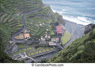 the village Ribeira da Janela at the North coast on the Island of Madeira in the Atlantic Ocean of Portugal.  Madeira, Porto Moniz, April, 2018