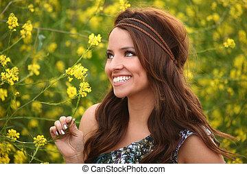 Pretty Girl in a Flower Field