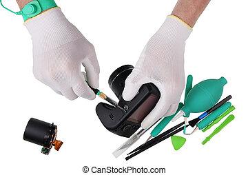 Professional repair of a modern digital photo camera in a European service center concept.