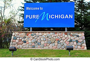 Welcome to Michigan sign greets visitors to the Great Lakes State.