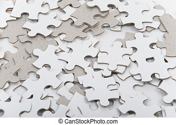 Background of numerous mixed blank puzzle pieces