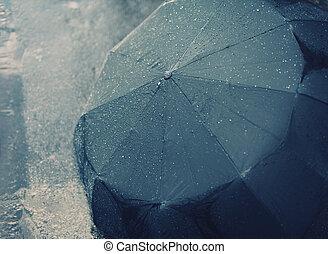 Rainy autumn day, wet umbrella