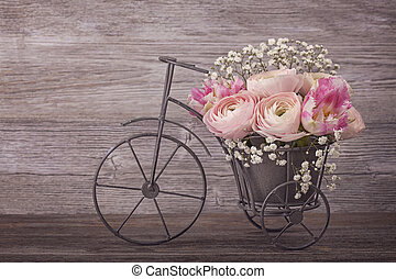 Ranunculus flowers in a bicycle vase
