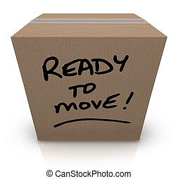 The words Ready to Move written on a cardboard box with black marker to indicate you are prepared to relocate or for moving to another location