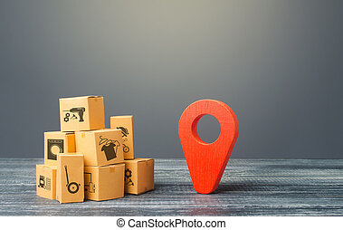 Red location pointer geolocation symbol and cardboard boxes. Global market and business, import and export. Distribution delivery of goods, freight transportation shipment. Logistics and warehousing.