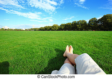 Relax barefoot enjoy nature in the green lawn