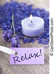 the word relax on a purple label with recreation background