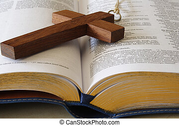 Wood cross on a page of the bible