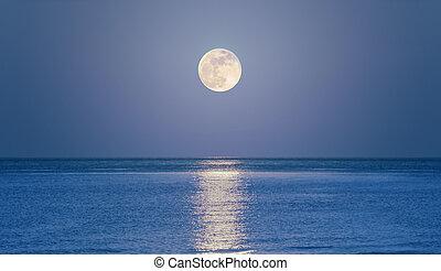 Rising moon on sea