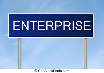 A blue road sign with white text saying Enterprise