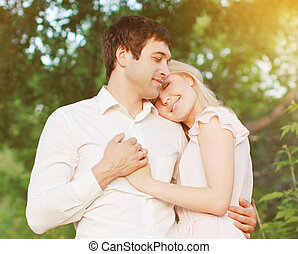 Romantic young couple in love outdoors, warm tender feelings