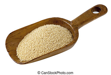 amaranth grain on a rustic wooden scoop, isolated on white