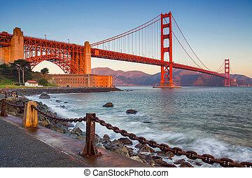 Image of Golden Gate Bridge in San Francisco, California during sunrise.