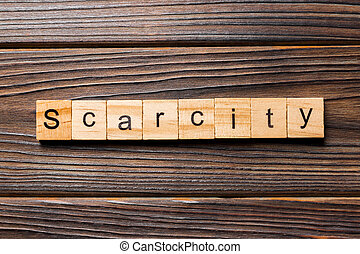 scarcity word written on wood block. scarcity text on wooden table for your desing, concept