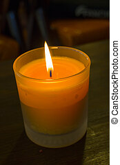 Scented candle lit in the dark