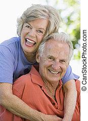 Senior couple sitting outdoors