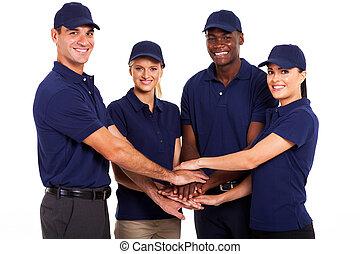 service team hands together