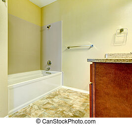 Simple new bathroom interior with white tub.