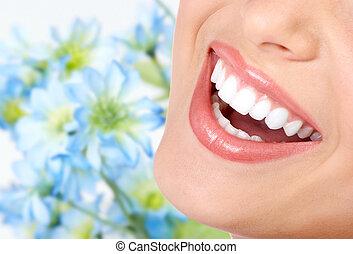 Woman smile and teeth. Dental health. Dentist.