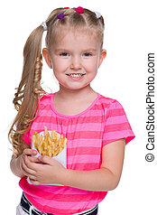 A smiling little girl with fries on the white background