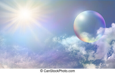 Blue sky with fluffy delicately color tinted clouds and a vibrant sunburst on left side with a large rainbow colored transparent bubble on right side