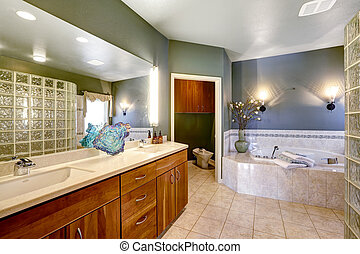 Spacious bathroom with whirlpool bath tub