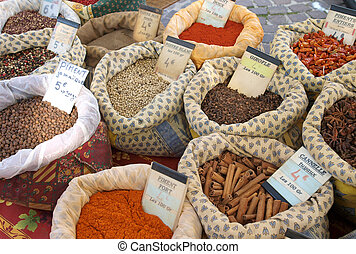 bags of bulk spices at a market in Provence