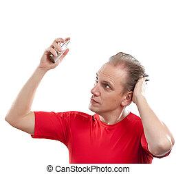 sports man spraying fragrance perfume
