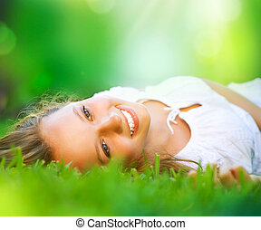Spring Girl lying on the Field. Happiness