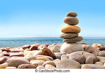 Stack of pebble stones on white background