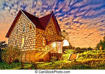 stone house at sunset