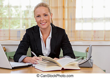 successful young businesswoman at desk with laptop computer and fracture