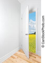 Summer field seen through the open door