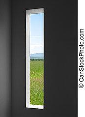 Summer landscape outside the window of a dark room