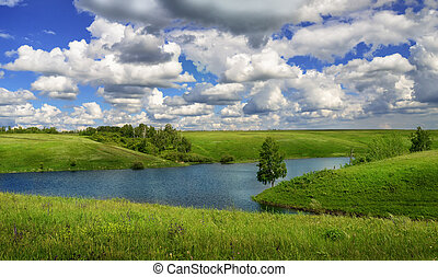 Summer landscape with river and meadows