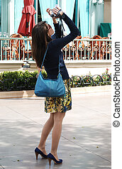 Young woman tourist taking pictures