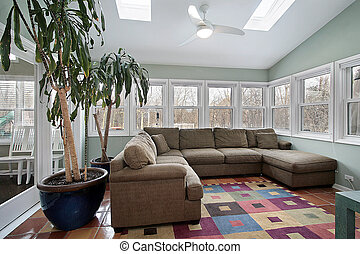 Sun room with wall of windows