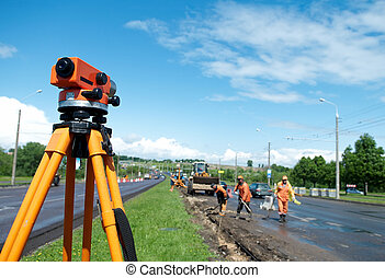 equipment theodolite tool at construction site works in summer