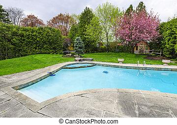 Swimming pool in backyard