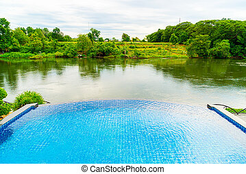 swimming pool with river view