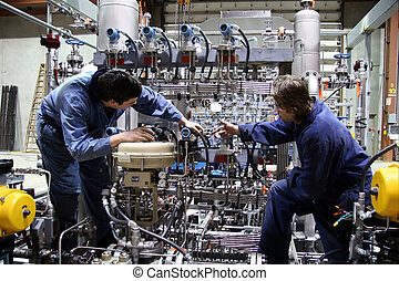 Two technician carry out the last inspection on a complex machinery