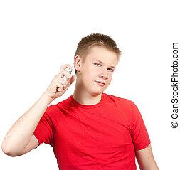 teenager spraying fragrance perfume