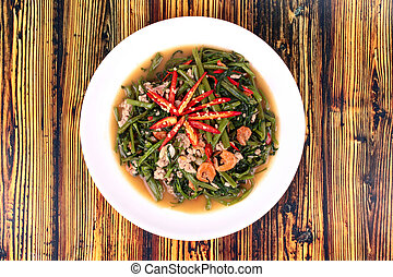 Fried spicy Chinese morning glory with minced pork and dried shrimps .