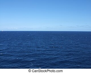 the ocean horizon with no clouds
