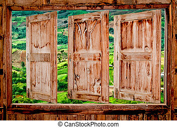 The Old wooden window with view mountain