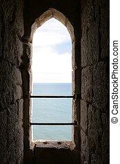 the sea seen through a castle window