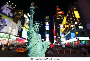 The statue of Liberty and times square