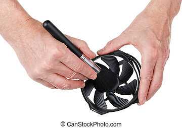 The technician engineer cleans a computer fan from dust with a soft brush concept.