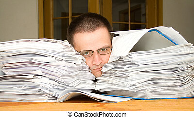 Sad man drowning in paperwork - looking for help - concept for overtime and deadlines